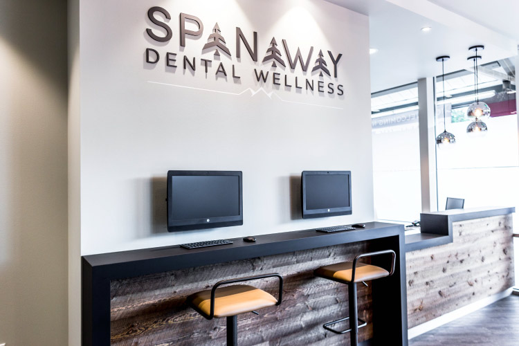 Spanaway Dental Office entry with computer screens and barstools